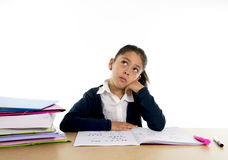 Cute latin school kid bored under stress with a tired face expression Royalty Free Stock Photos