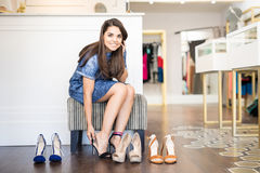 Cute Latin woman buying shoes Stock Photography