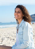 Cute latin woman with curly hair dreaming at beach Royalty Free Stock Photo