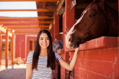 Cute Latin woman and her horse Royalty Free Stock Image