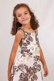 Cute Latina Girl. Wearing a brown  and white dress Royalty Free Stock Image