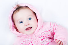 Cute laughing baby with blue eyes in snow suit Royalty Free Stock Photos