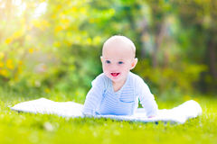 Cute laughing baby in the garden Stock Images