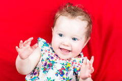Cute laughing baby girl in a summer dress Royalty Free Stock Photo