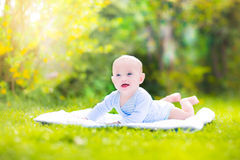 Cute laughing baby in the sunny garden Royalty Free Stock Photo