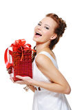 Cute laughing girl holding the red box present Royalty Free Stock Photo