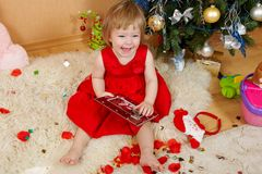 Cute laughing girl in red dress Stock Photo