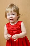 Cute laughing girl in red dress Stock Photos