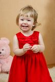 Cute laughing girl in red dress Stock Image