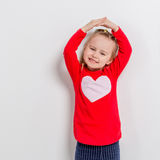Cute laughing girl in red sweater Stock Image
