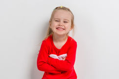 Cute laughing girl in red sweater Royalty Free Stock Photo
