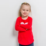 Cute laughing girl in red sweater Royalty Free Stock Photos