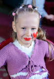 Cute laughing little girl in pantomime makeup Stock Image