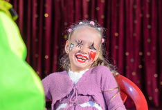 Cute laughing little girl in pantomime makeup Royalty Free Stock Image