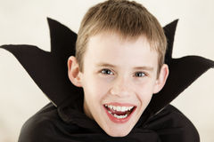 Cute laughing vampire boy close up Royalty Free Stock Images