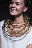 Cute laughing woman with golden necklace Stock Photography