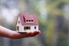 New house for you. Cute layout of the house. The concept of new housing for family Stock Photos