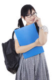 Cute learner standing in the studio Stock Image