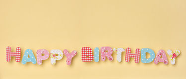 Cute Letters on Yellow - Happy Birthday, with a nice little shad Stock Photo