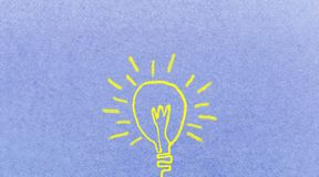 Cute light bulb idea. Easy brush illustration paint on blue pape Royalty Free Stock Photo
