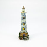 Cute lighthouse resin doll for decoration isolated on white back Stock Images