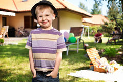 Cute liitle boy wiearing small hat Stock Photography