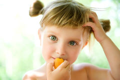 Cute liitle girl with the apricot Stock Image