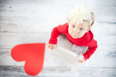Cute liitle girl. With paper heart Stock Photo