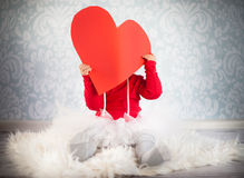 Cute liitle girl with a paper heart Stock Photography