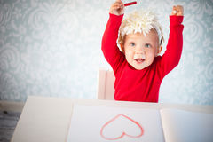 Cute liitle girl sketching a heart Stock Image