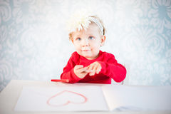 Cute liitle girl sketching a heart Royalty Free Stock Images