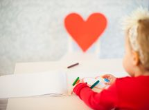 Cute liitle girl sketching a heart Stock Photos
