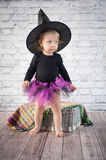 Cute liitle witch. With funny hat Royalty Free Stock Photo
