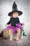 Cute liitle witch. With funny hat Royalty Free Stock Photos