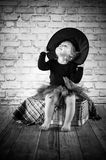 Cute liitle witch. With funny hat Royalty Free Stock Images