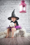 Cute liitle witch. With funny hat Stock Photography
