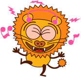 Cute lion animatedly listening to music thanks to its earphones Royalty Free Stock Photography
