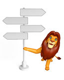 Cute Lion cartoon character with way sign Stock Photo