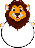 Cute lion cartoon holding blank sign Stock Images