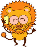 Cute lion speaking animatedly on a cellphone Royalty Free Stock Images