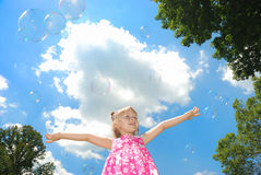 Cute litle girl and soap bubbles Royalty Free Stock Photos
