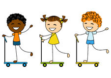 Cute litlle kids on scooters Stock Photo