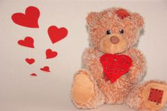 Cute littele bear with red heart. stock photos