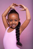 Cute little African American girl dancing Stock Image