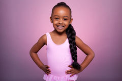 Cute little African American girl dancing Stock Photo