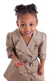 Cute little african american girl with a lollipop. Portrait of a cute little african american girl with a lollipop, isolated on white background stock images