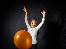 Cute little african-american girl plaing with balloon Stock Image