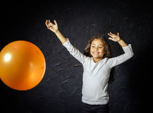 Cute little african-american girl plaing with balloon Stock Images