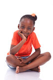 Cute little african american girl sitting on the floor - Black c Stock Photography
