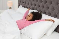 Cute little African-American girl sleeping stock photos
